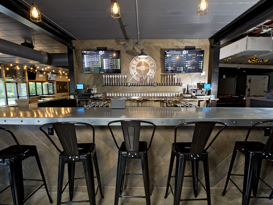 West Side Brewery will open June 30, 2017, at 3044 Harrison Ave. in Westwood. The bar features multiple taps and big screen displays giving in-depth information on the various brews available. Photo: David Sorcher