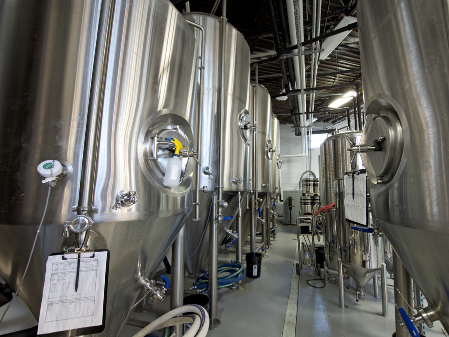West Side Brewery will open June 30, 2017, at 3044 Harrison Ave. in Westwood. Brewing vats line a wall in the back room. Photo: David Sorcher