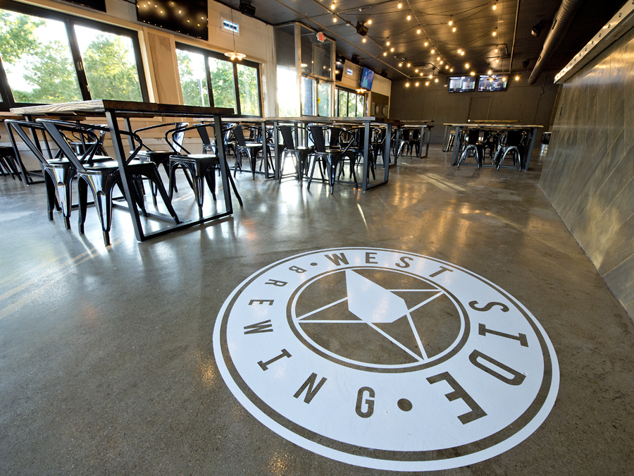 West Side Brewery will open June 30, 2017, at 3044 Harrison Ave. in Westwood. The brewery logo marks the floor next to the bar. Photo: David Sorcher